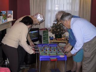 Photo of the family playing table football